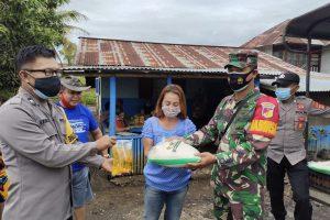 Wujud Solidaritas, Polres dan Kodim Minahasa Bantu Warga Terdampak Banjir di Papakelan
